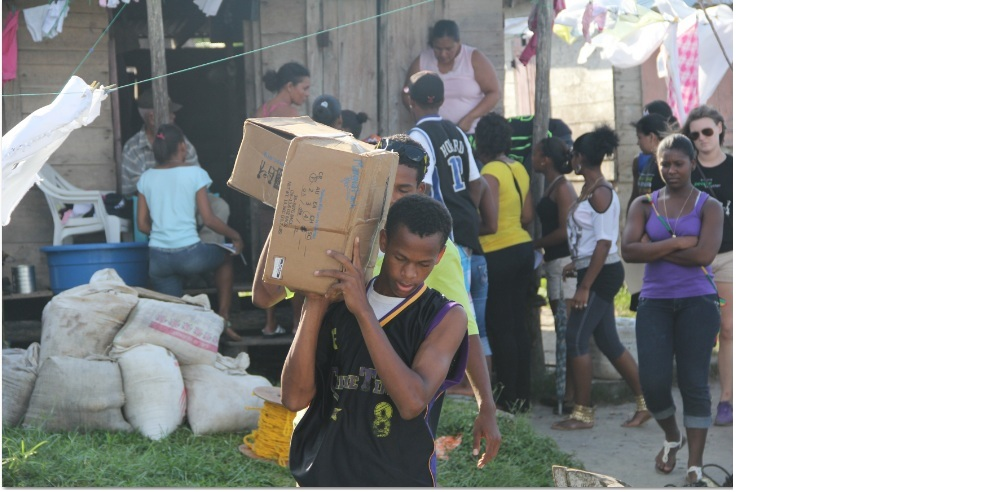 The youth of Pearl Lagoon delivering food supplement to families in their community.